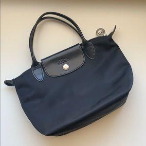 Mini black Longchamp bag